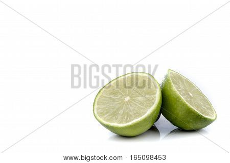 Two halves of a lime isolated on white