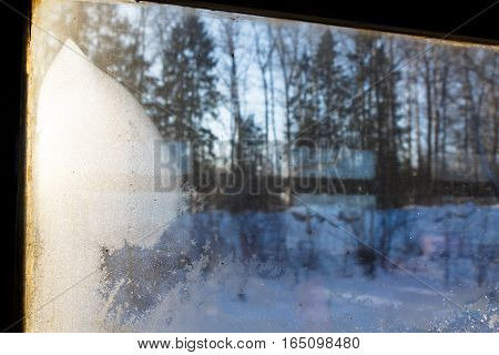 Frost. Winter Forest Lit By The Sun Outside The Window Of The Tr