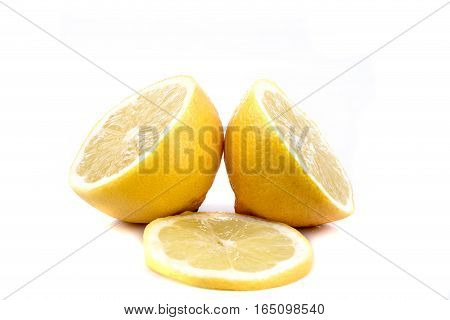 Two halves of a lemon and a slice