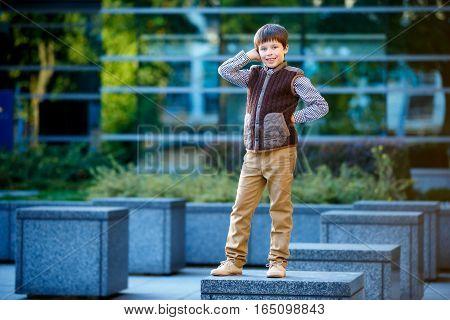 Stylish little boy in fashionable clothes. Children's fashion