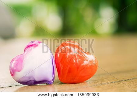 Hearts On Table With Blur Nature Background. Valentine's Day Background