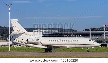 Kloten, Switzerland - 29 September, 2016: a Dassault Falcon 7X jet taxiing in the Zurich Airport. Zurich Airport, also known as Kloten Airport, is the largest international airport in Switzerland.