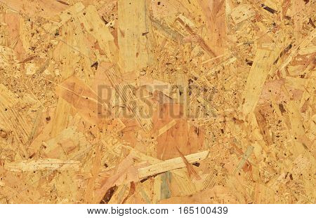 Yellow wooden panel with splinters as background