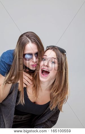 Studio Portait Of Young Twin Sisters Embracing