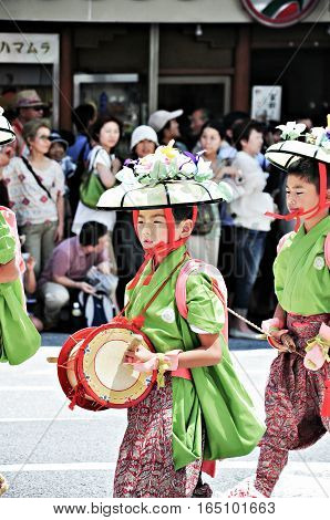 Kyoto Japan - July 17 2011: Unidentified Japanese kids performing in the parade in Gion Festival Kyoto Japan