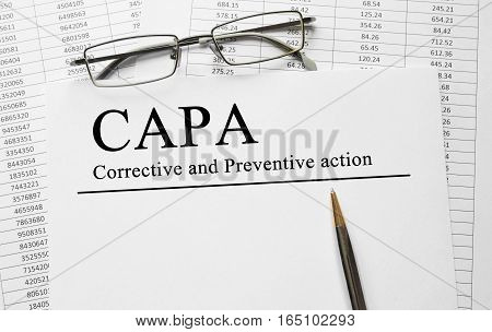 Paper with Corrective and Preventive CAPA action plans on a table