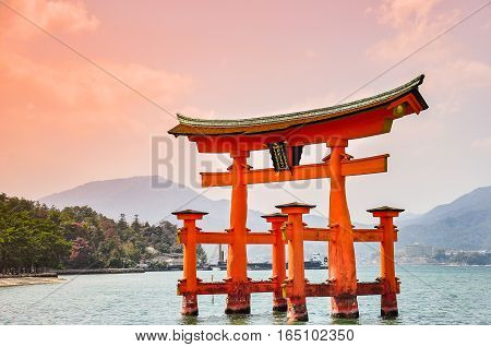 Miyajima Hiroshima Japan at the floating gate of Itsukushima Shrine. (gate sign reads Itsukushima Shrine)