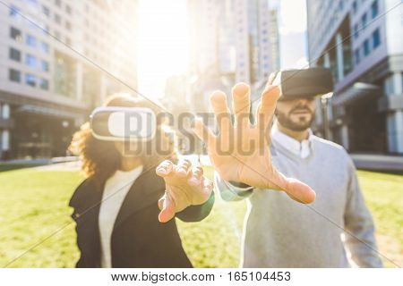 Business Woman And Man Wearing Virtual Reality Headset