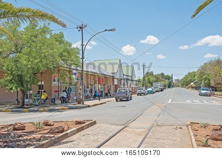 FAURESMITH SOUTH AFRICA - DECEMBER 31 2016: A street scene in Fauresmith one of only three towns on earth where the railway line runs down the centre of the main road