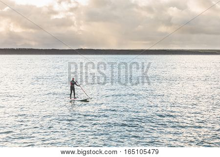 Man With Paddle Board Over The Cliffs