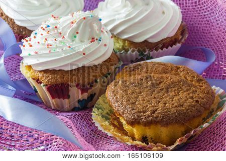 Tasty muffin cakes with and without protein cream