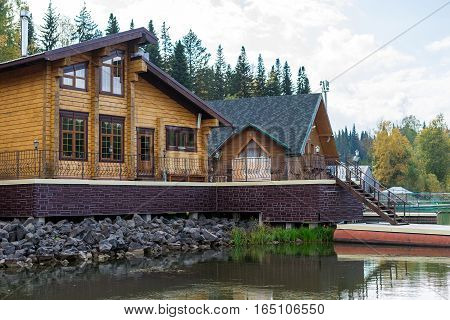 House and bath in the lake. Pier near the water cottage guest house woodland.
