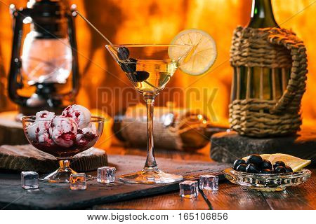 Martini cocktail and ice-cream over fire lighting background