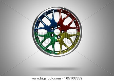 Colorful alloy rim floating in the air at grey background
