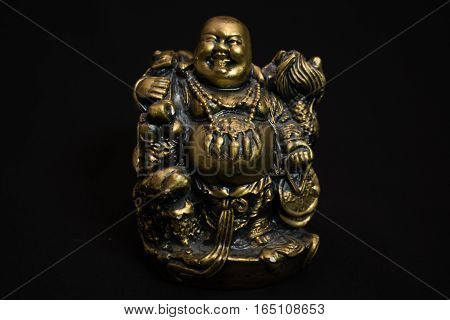 Chinese figurine Hotei, the laughing Buddha is a symbol of prosperity and money, unfocused poster