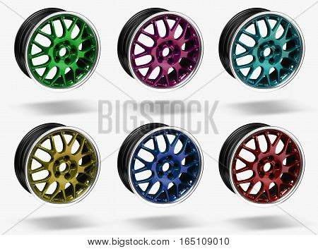 Colorful alloy rims floating in the air at white background