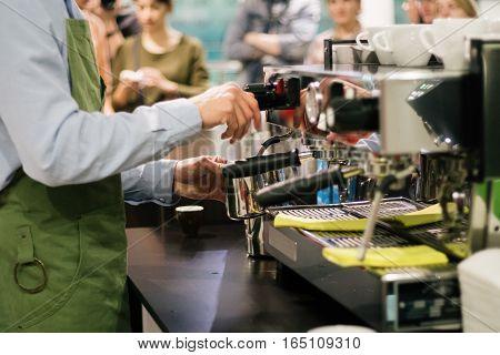 Barista prepares cappuccino latte espresso service coffeeshop
