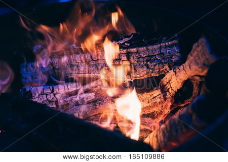hot Burning logs andglowing coal, firewood  background