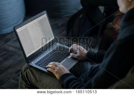 The man in the dark has been programming, website development, software.