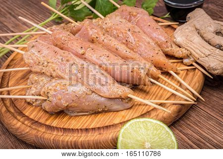 Thai raw chicken satay . Concept of cooking.