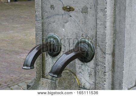 Ancient water tap on a market place