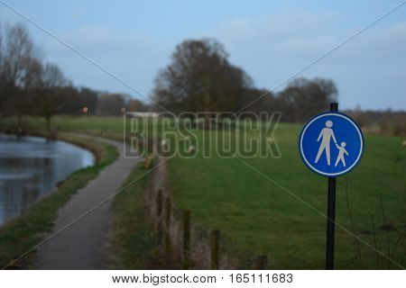 Sign of a mandatory footpath in blue
