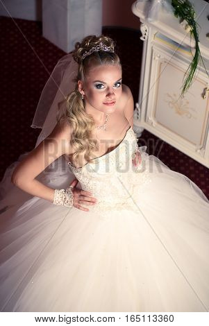 beautiful young bride waiting for ceremony in apartments