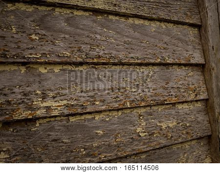 Weathered wooden boards with little a trace of peeling paint