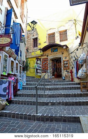 CHANIA, CRETE - SEPTEMBER 16, 2016 - View along a narrow steep stepped old town shopping street Chania Crete Greece Europe, September 16, 2016.