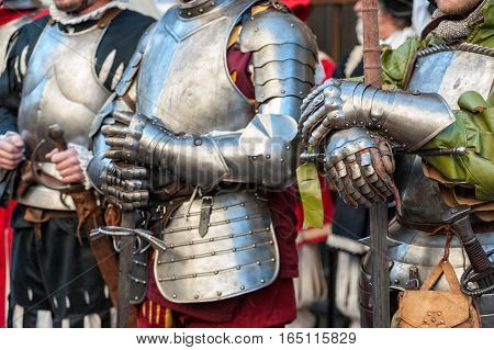 The joust of Medieval knights in body armor and big swordsduring historical reenactment in Florence
