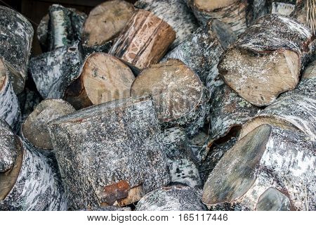 a pile of chopped firewood in winter