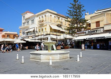 CHANIA, CRETE - SEPTEMBER 16, 2016 - Fountain in the Pl El Venizelou square with tourists enjoying the sights Chania Crete Greece Europe, September 16, 2016.