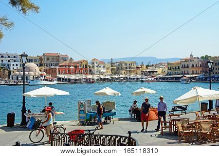 CHANIA, CRETE - SEPTEMBER 16, 2016 - View of the inner harbour with quayside stalls and restaurants Chania Crete Greece Europe, September 16, 2016.