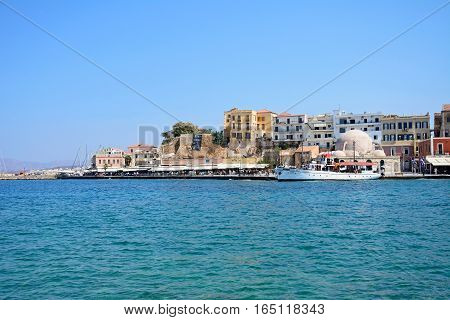 CHANIA, CRETE - SEPTEMBER 16, 2016 - View of the inner harbour towards the mosque and restaurants Chania Crete Greece Europe, September 16, 2016.