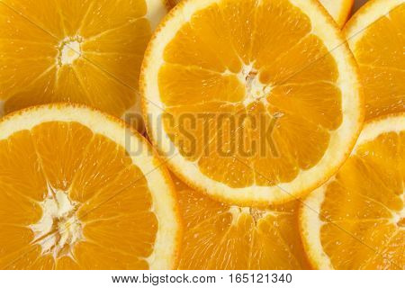 Top view of numerous fresh orange fruit cross sections