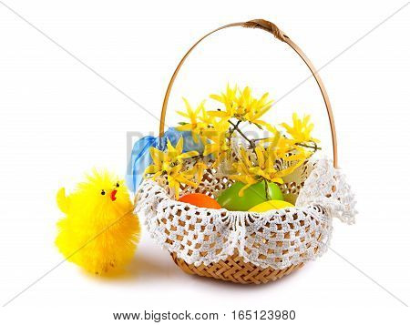 Easter chicken and easter eggs in basket on white background