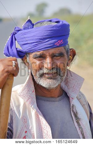 GUJARAT, INDIA - DECEMBER 18, 2013: Portrait of a Rabari shepherd