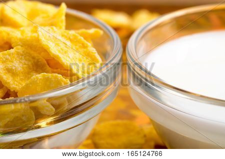 Dry Corn Flakes And Milk In A Transparent Cups