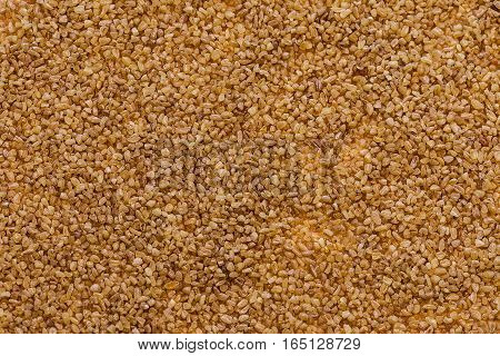 Background texture of brown bulgur. Close up