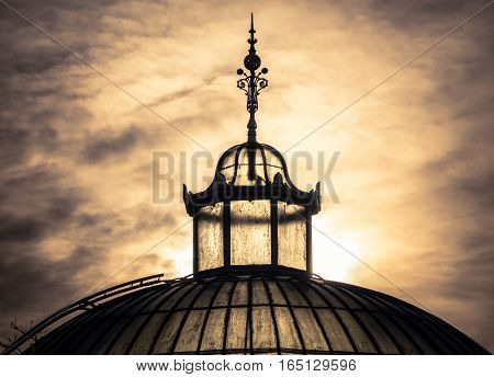 The Top Of A Victorian Eta Glasshouse Against A Winter Sunset Sky In Glasgow Scotland