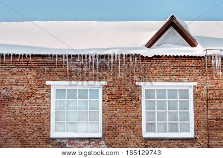 icicles on a roof of the beautiful house