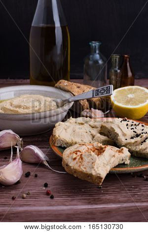 The hummus and ingredients in rustic style.