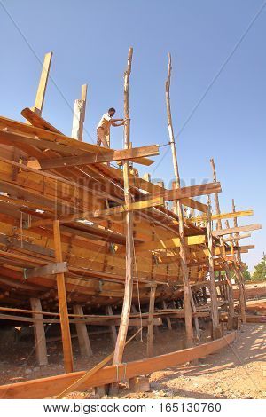 MANDVI, GUJARAT, INDIA - DECEMBER 21, 2013: Traditional wooden Dhow building