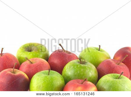 Red and green ripe apples, located in lower part of the photo, isolated on white background close up