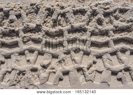 Thick Tire Treads in Sand Background Image