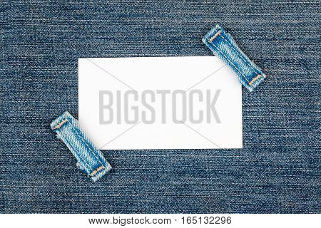 Business card with two straps jeans lies on the dark denim with space for your text
