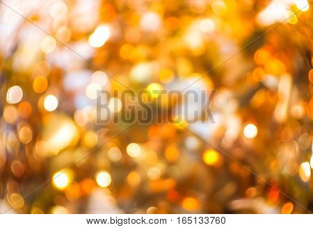 De focused gold and white bokeh twinkling lights background, soft focus / De focused gold and yellow bokeh twinkling lights background