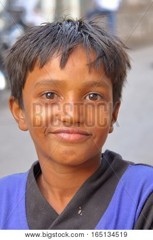 GONDAL, GUJARAT, INDIA - DECEMBER 24, 2013: Portrait of a young boy