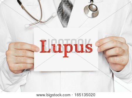 Doctor Holding A Card With Lupus, Medical Concept