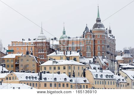 STOCKHOLM - JAN 08 2017: Buildings with brick wall in central stockholm a sunny winter day ice on the sea. January 08 2017 in Stockholm Sweden